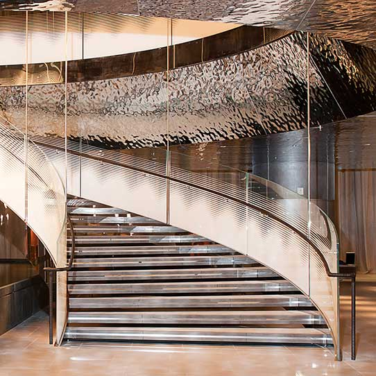 Hamad International Airport in Doha, Al Mourjan Business Lounge, Spiral Stair, Cladding EXYD-M, Photo Noly Pronto Photography, 2014