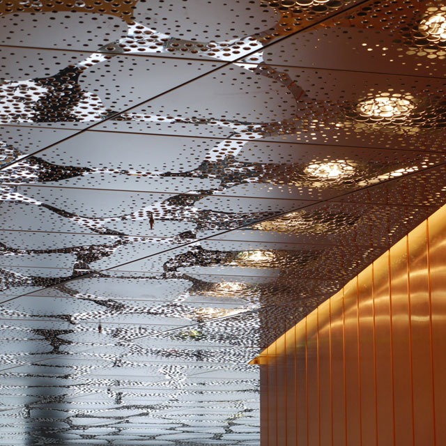 Stockholm, Waterfront Building, Reception Hall, Stainless Steel Ceiling and Copper Wall, Grid Ceiling, Panels Type EXYD-F with Pattern Perforation, Photo EXYD