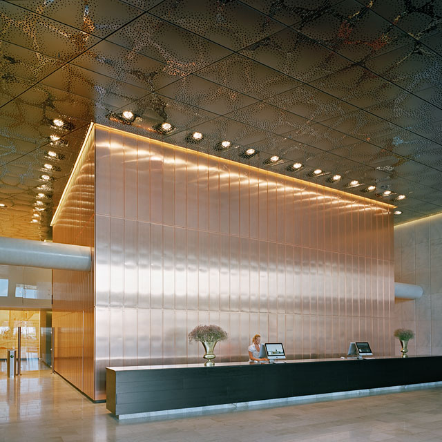 Stockholm, Waterfront Building, Reception Hall, Stainless Steel Ceiling and Copper Wall, Grid Ceiling, Panels Type EXYD-F with Pattern Perforation, Photo Michael Perlmutter