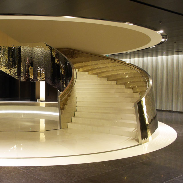 Vienna, Hotel Melia Vienna in DC Tower 1, Entrance Hall with Self-Supporting Spiral Stair, Interior Work SFL, Cladding EXYD-M, Photo EXYD